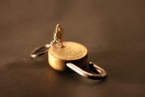 gold key and padlock